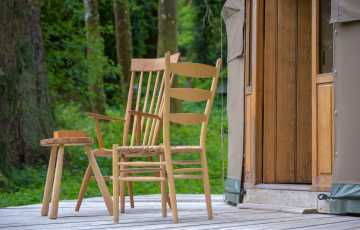 2 handmade Winsor chairs add to the charm of the yurt for 5