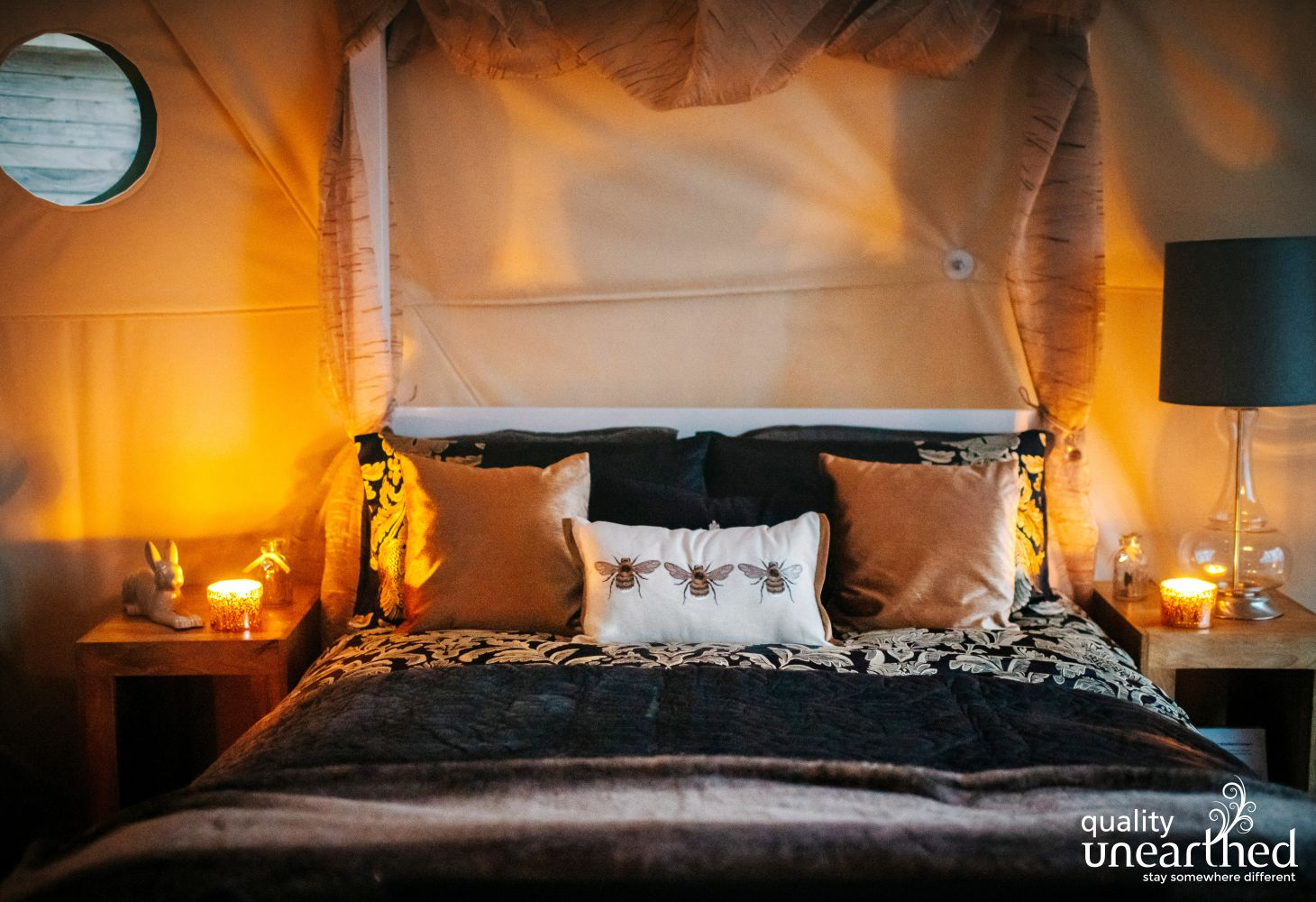 A cosy, romantic atmosphere with tealights inside the luxury glamping geodome