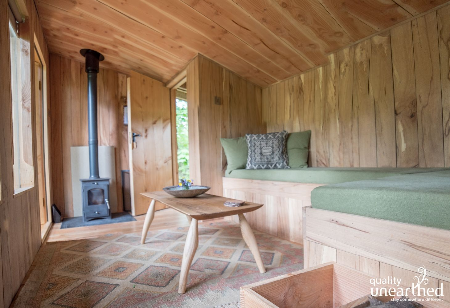This is the wooden clad living area at the treetop cabin for 3