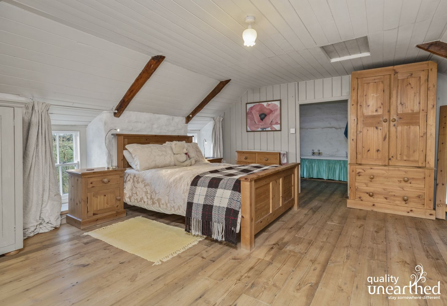 Llanger holiday cottage - master bedroom wardrobe 2 wooden chests bedside cupboards ensuite