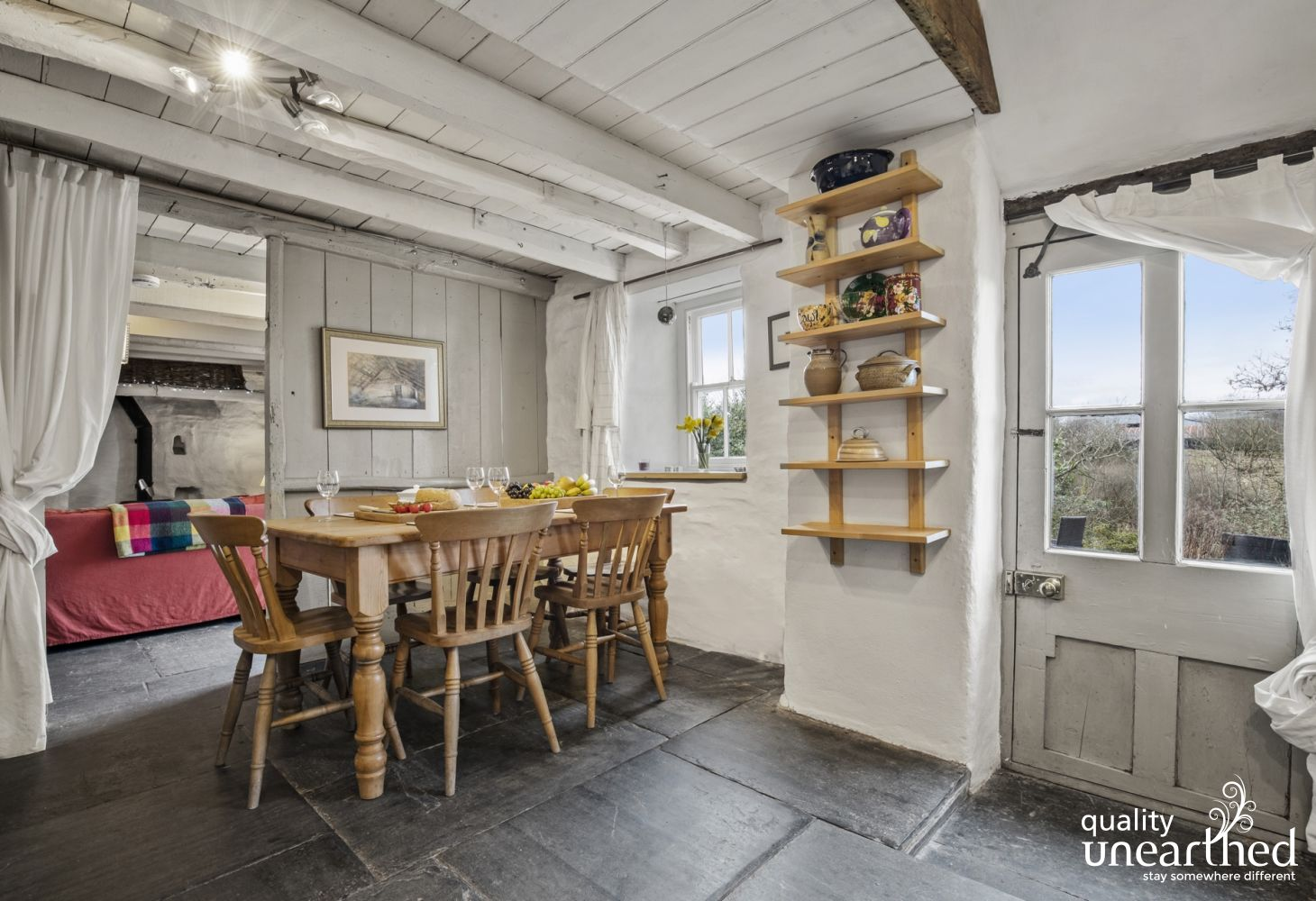 Cardigan Bay cottage holiday - dining area pine table, chairs