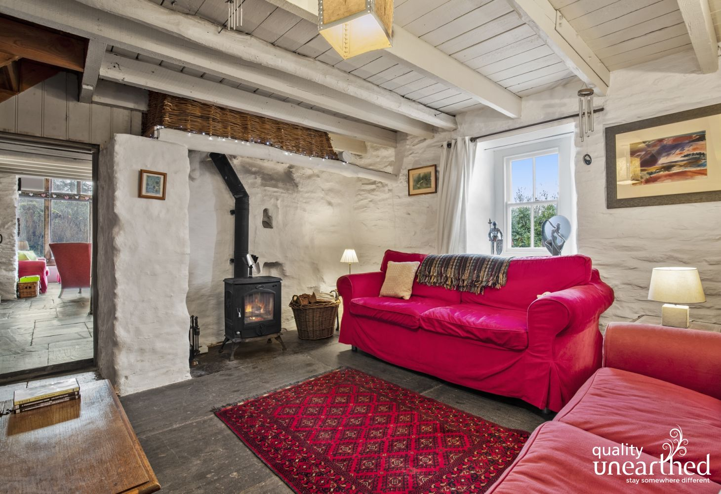 Cottage holiday near Newcastle Emlyn - sitting room 2 comfortable sofas wood burner