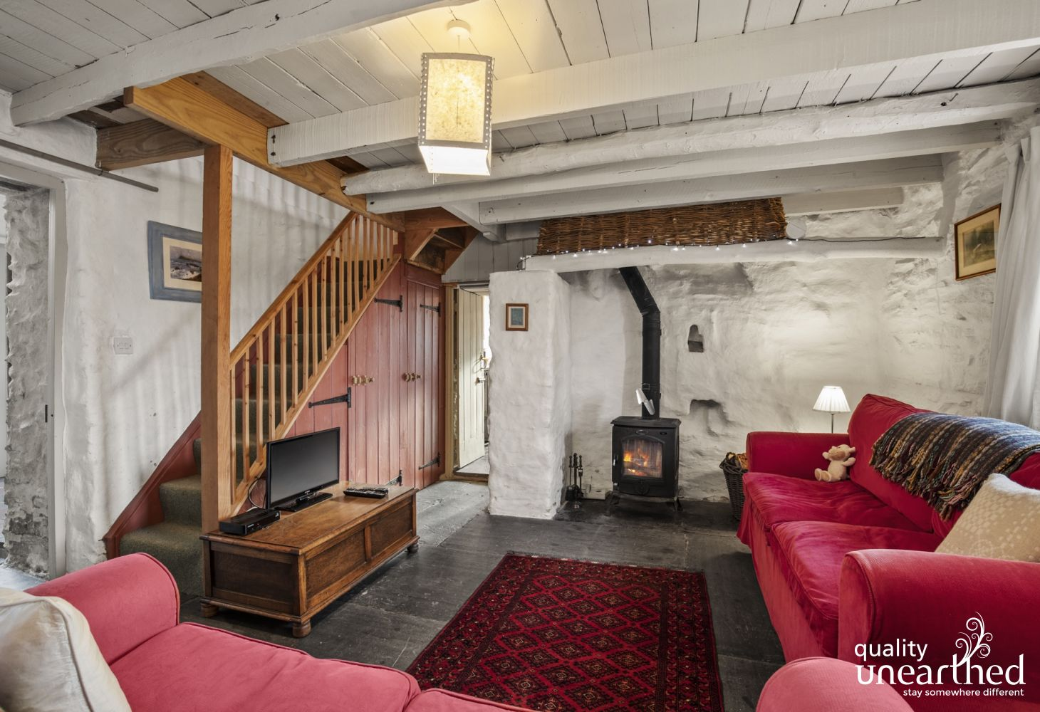 Cottage holiday Llandysul - cosy sitting room in the heart of the cottage two sofas, wood burner and TV