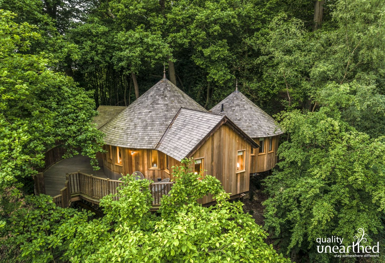 The cedar clad treehouse looks like a 5 star haven in the middle of the Sussex woodland