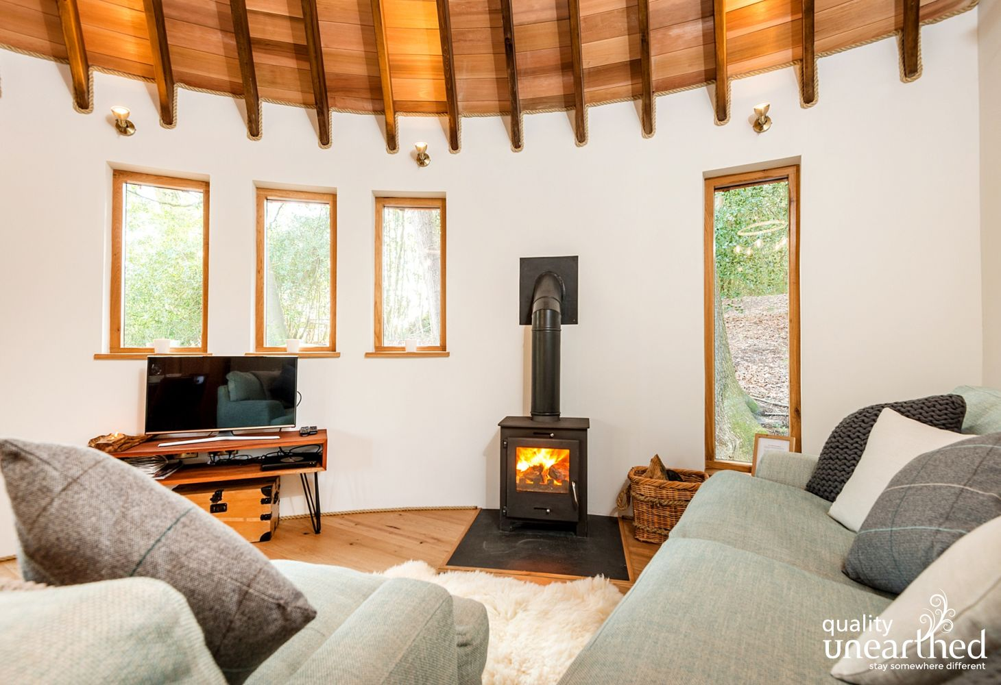 A roaring log burner, comfy seats and a sat tv in the treehouse living area