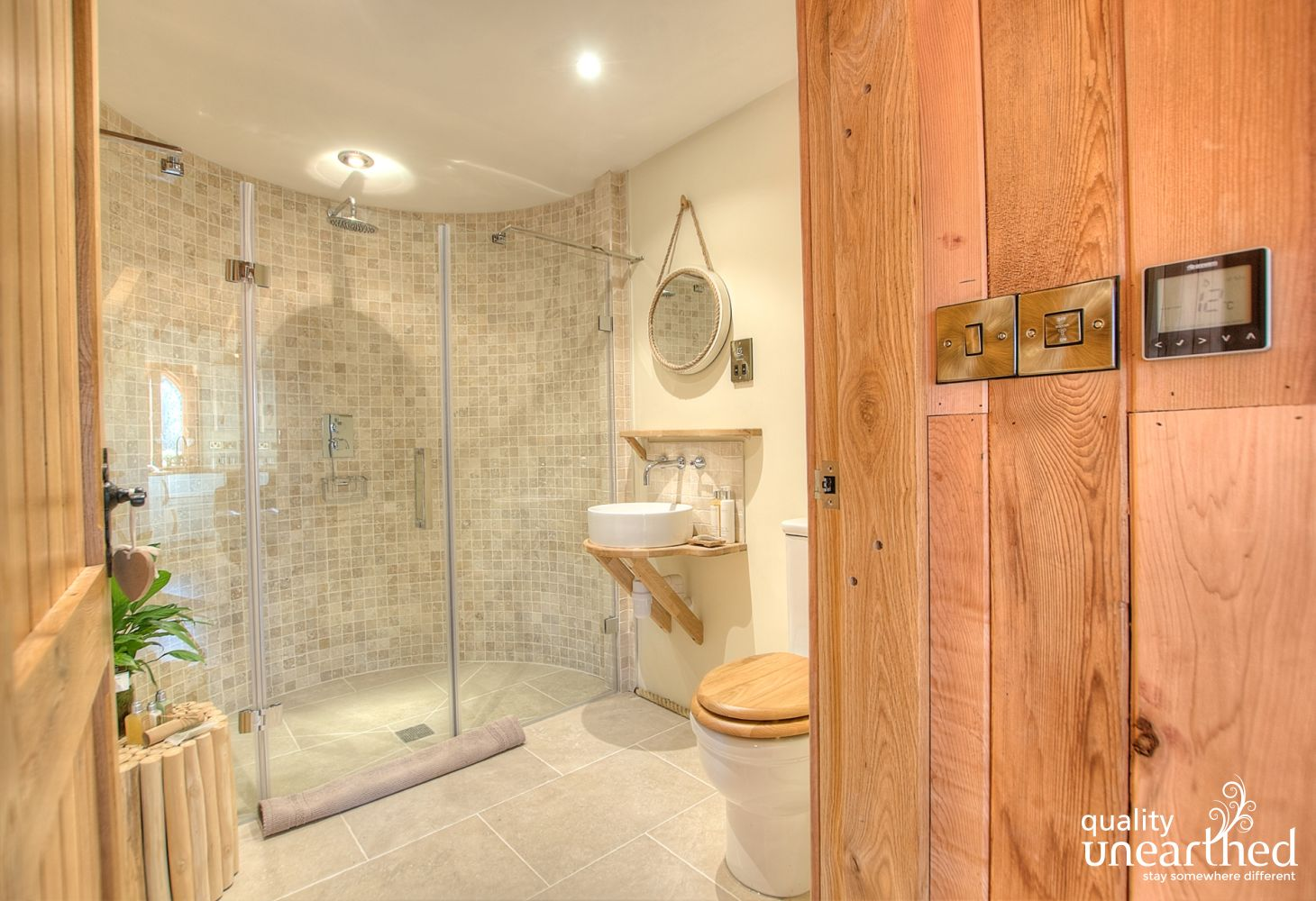 A 5 star treehouse shower room with an extra-large walk in shower and 5 star look