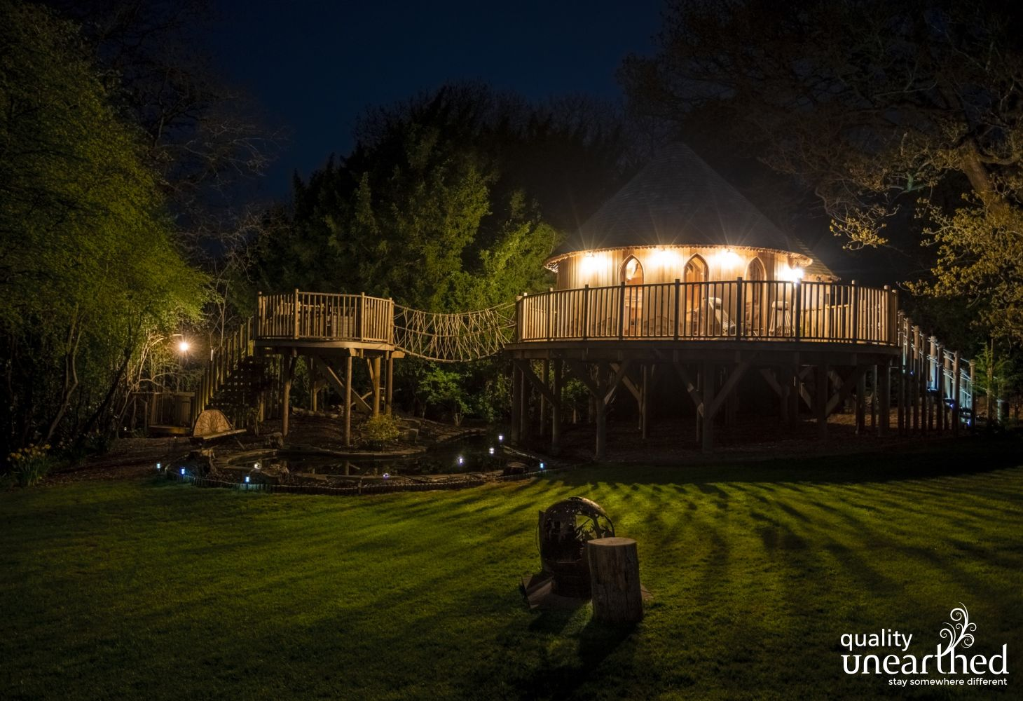 Nighttime at Trewalter Treehouse. The Dark skies of the Breacon Beacons envelop the cedar treehouse and hot tub