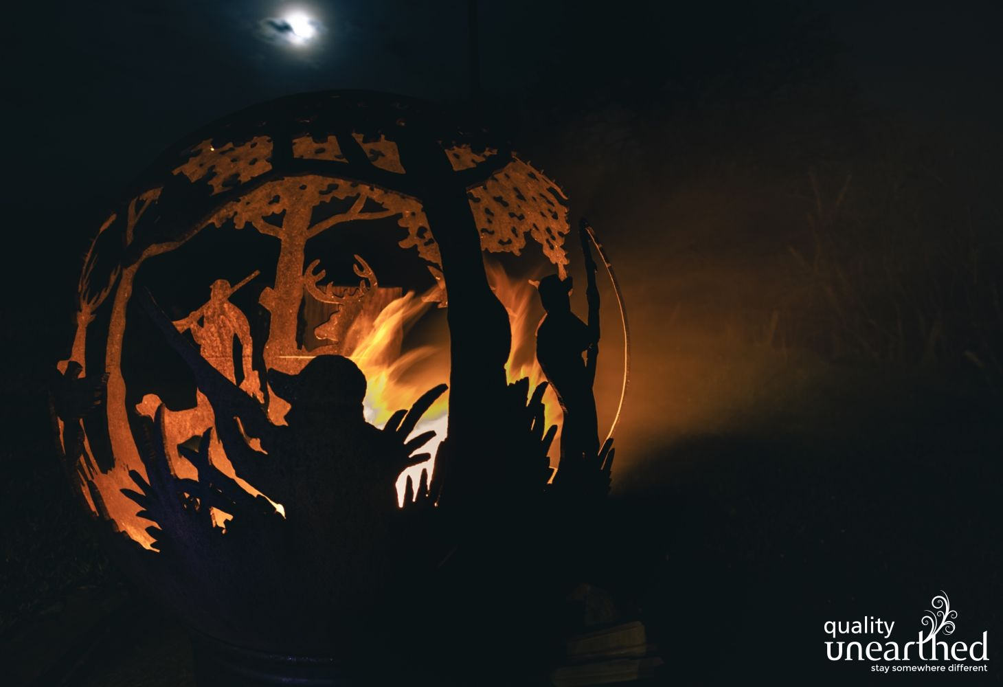 A handmade iron fire pit in the style of a fire ball sits under the dark sky Breacon Beacon night at the treehouse