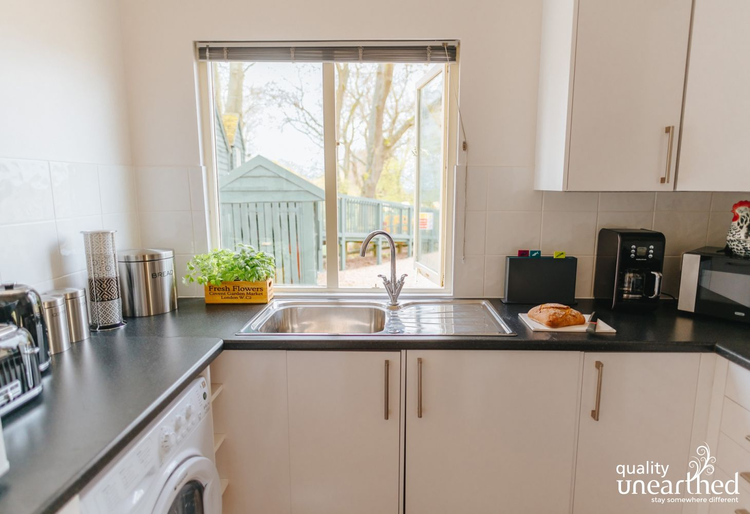 The fitted modern kitchen has all a family of 5 could need on a glamping holiday