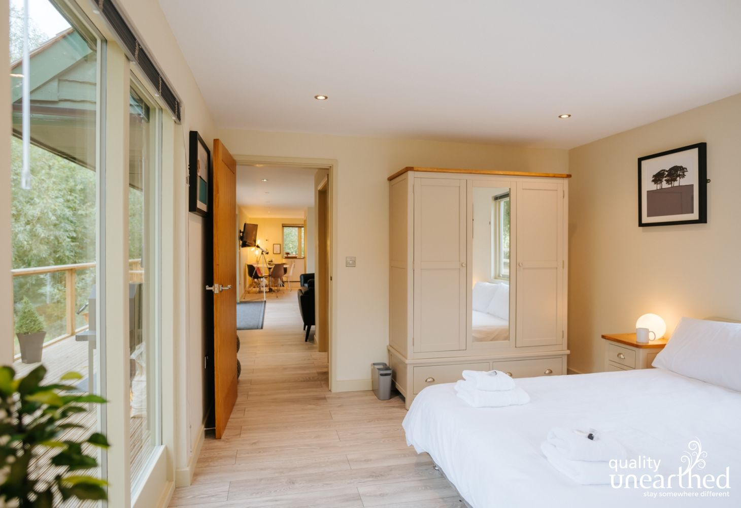 One of the spacious double bedrooms opens directly onto the treehouse terrace