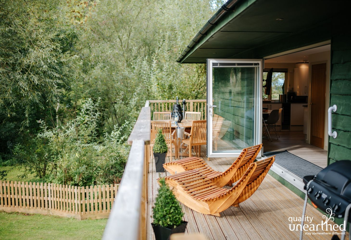 The treehouse deck overlooks the private garden