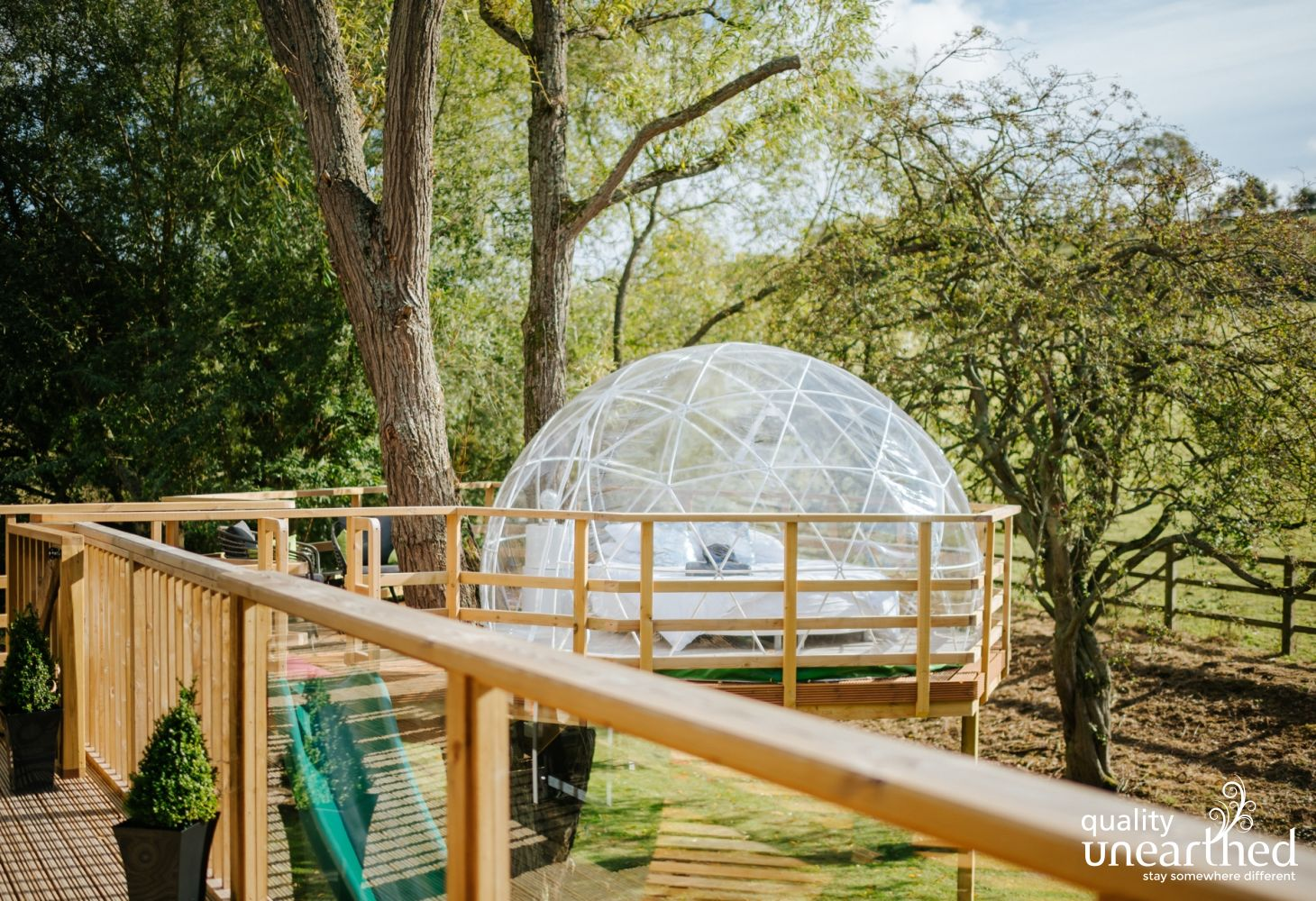 The geodesic dome for 2 sits to the left of the treehouse terrace
