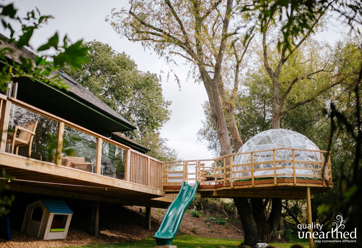 Slide down from the family treehouse to the private garden
