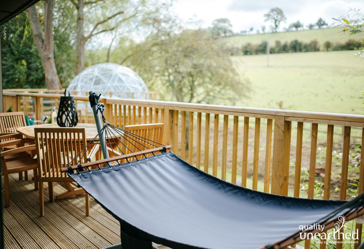 A full size hammock beckons guests of the family treehouse to relax
