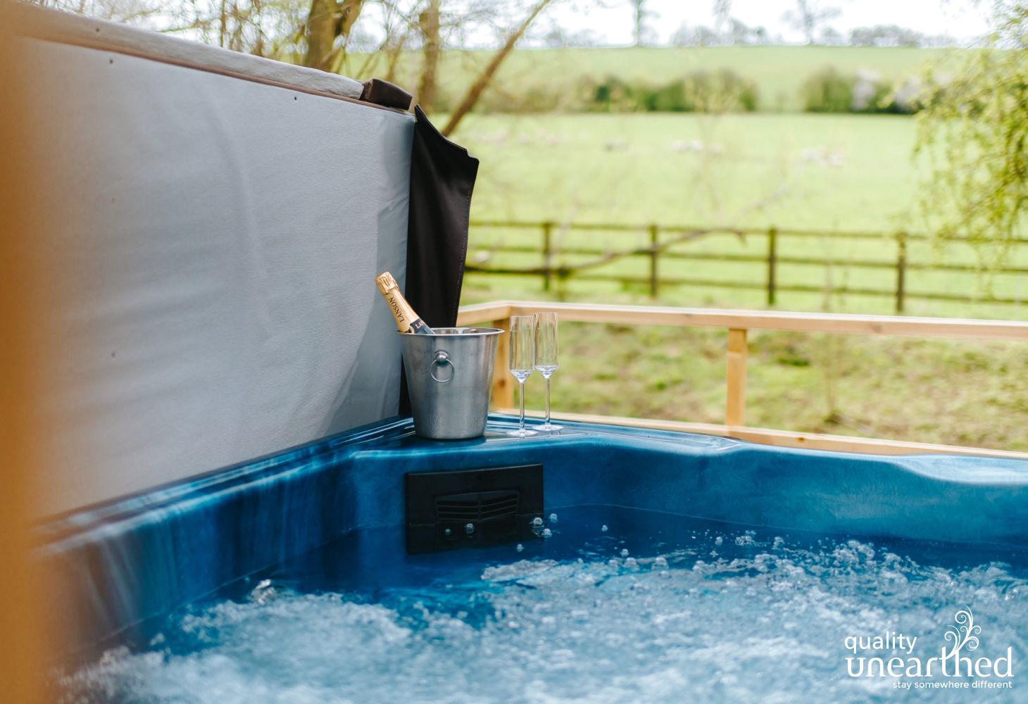 The hot tub at the family treehouse looks over farmland