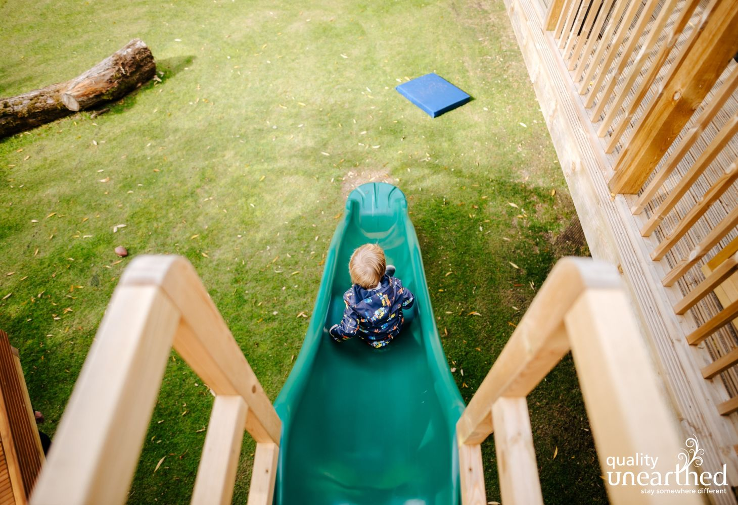The slide from the terrace to the garden at the family treehouse