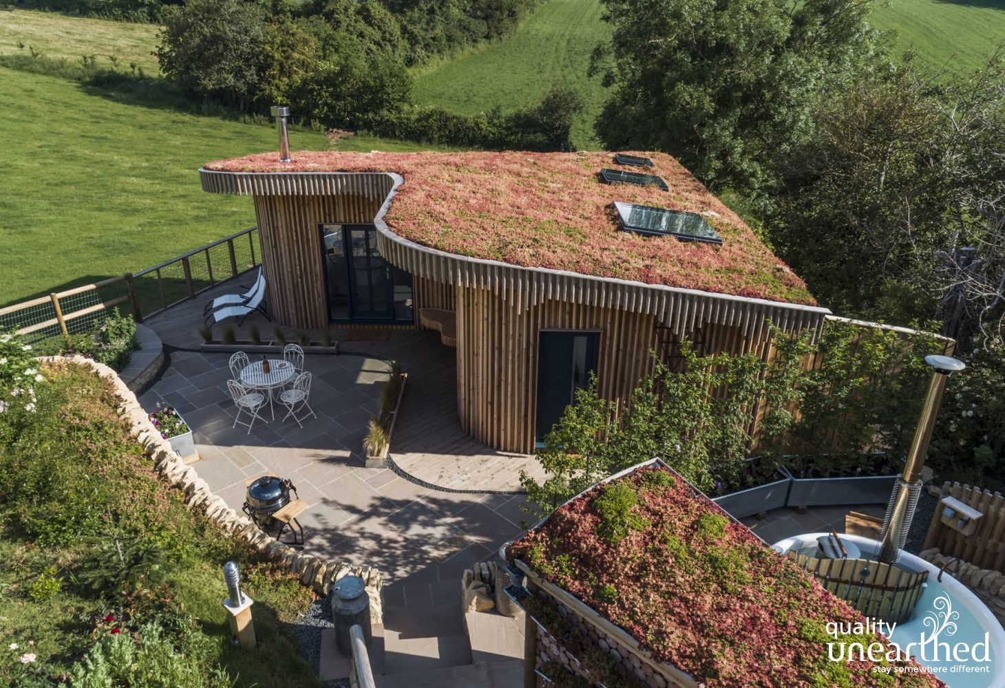 The wooden cabin sits in the hills with the Malvern countryside surrounding it