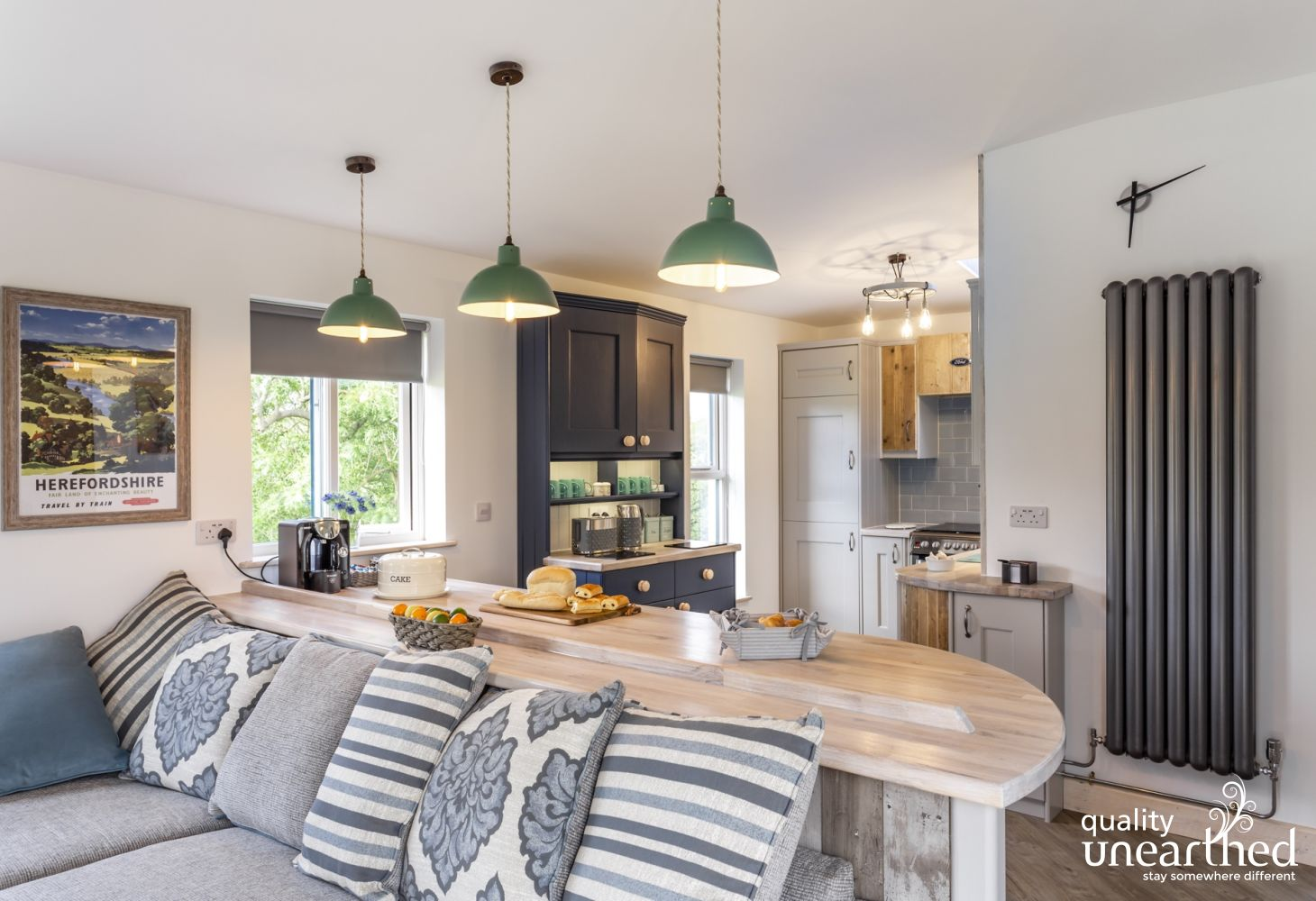 The open plan kitchen & living room at this wooden lodge has a stylish contemporary look