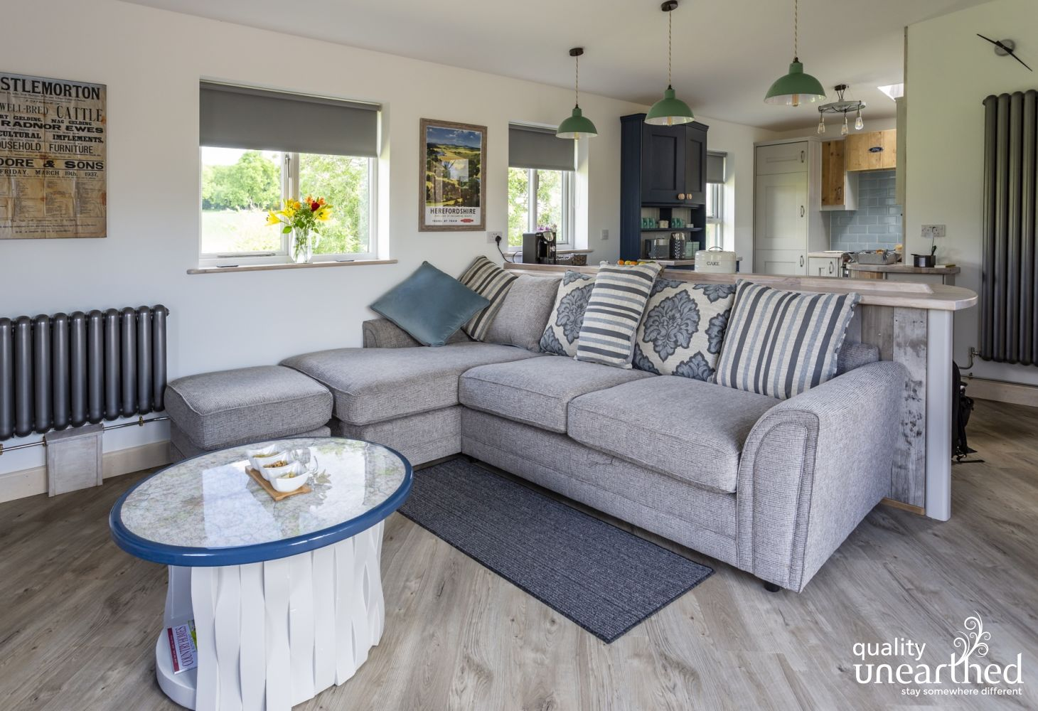 There�s a stylish palette of natural colours in the open plan living/kitchen with windows from the luxury lodge overlooking the Malverns countryside
