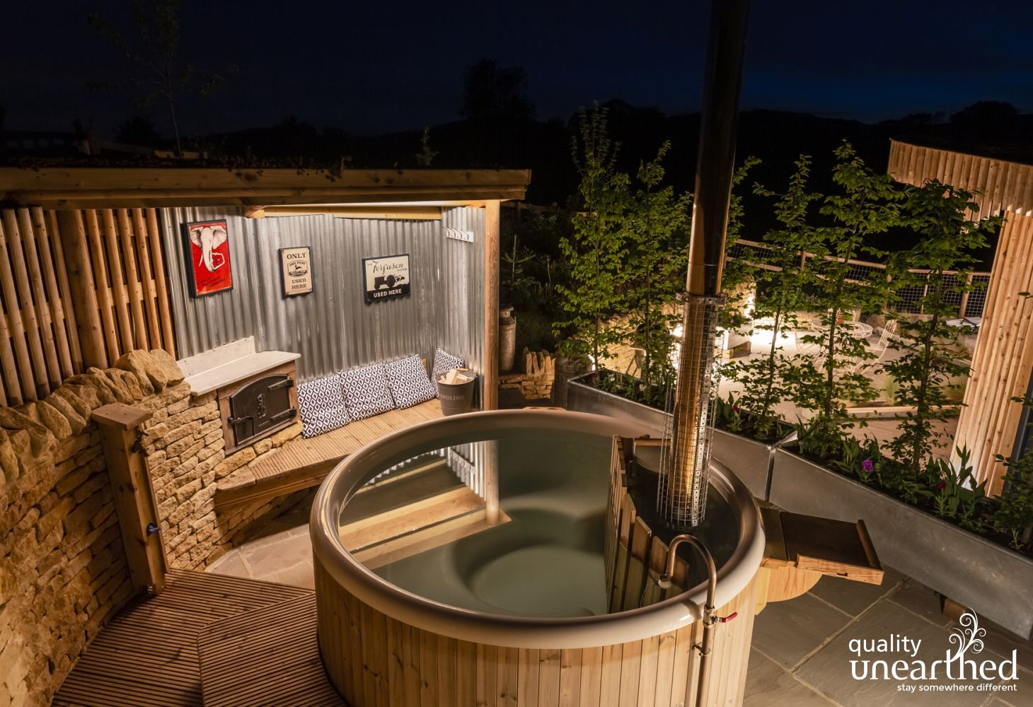 The wood fire hot tub and pizza oven on the terrace of the glamping lodge beckons you for a dip and some star gazing