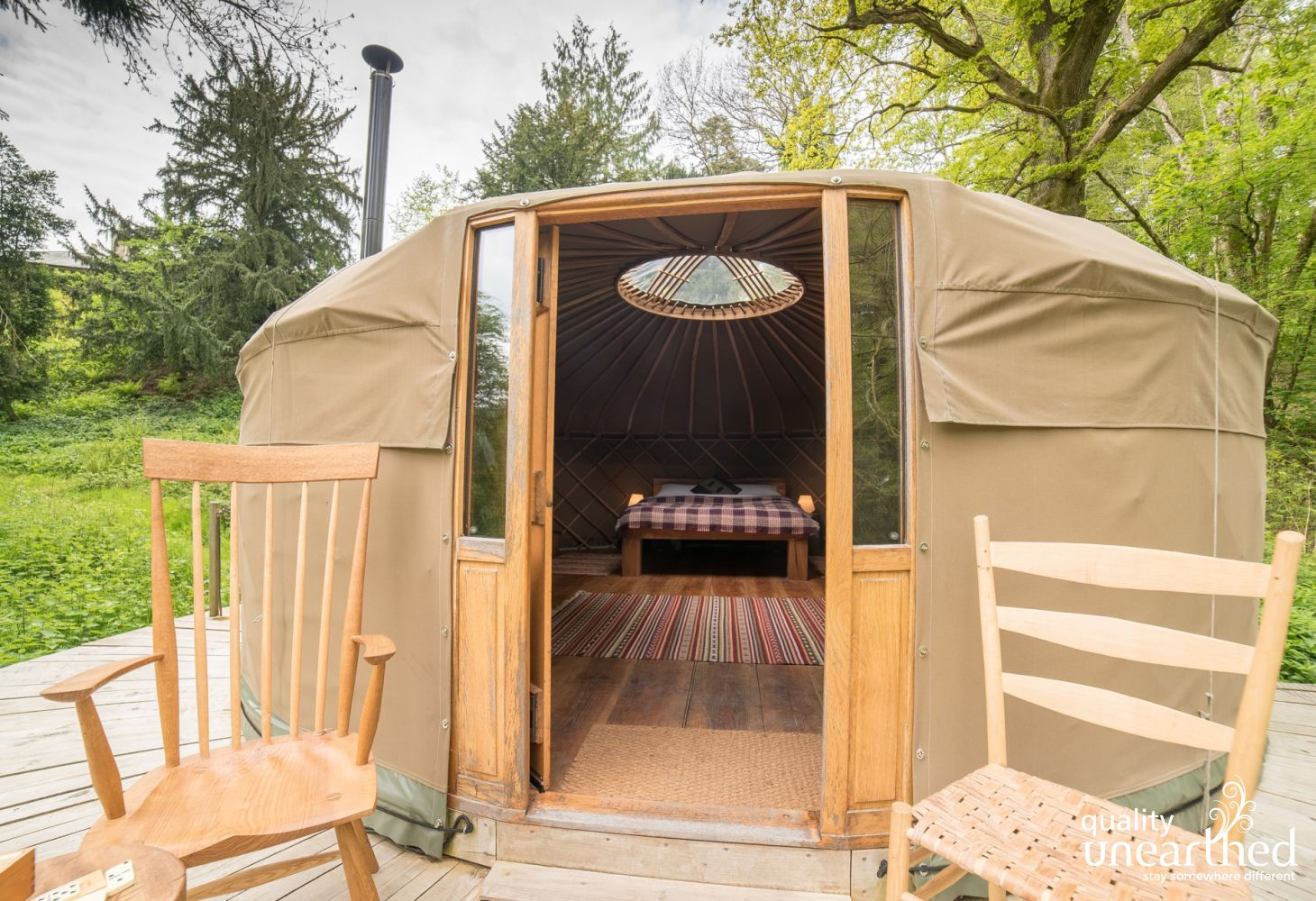 A peek through the classic low door of the yurt shows the crown and the star gazing potential