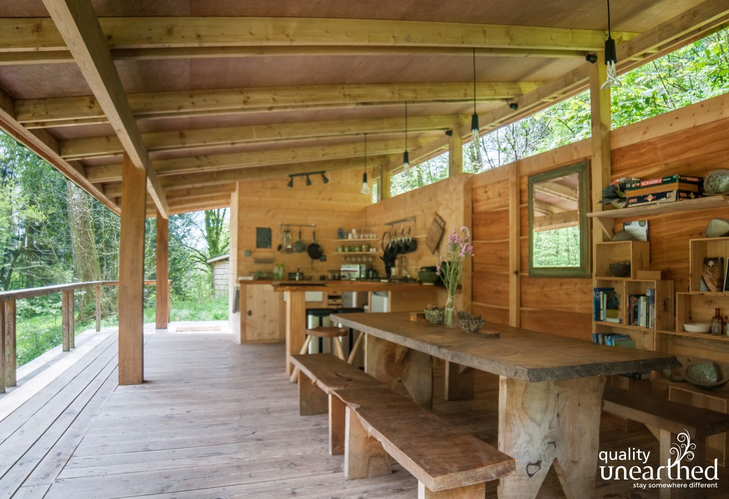 The communal dining area with a HUGE, handmade dining table, only 1 min from the family yurt