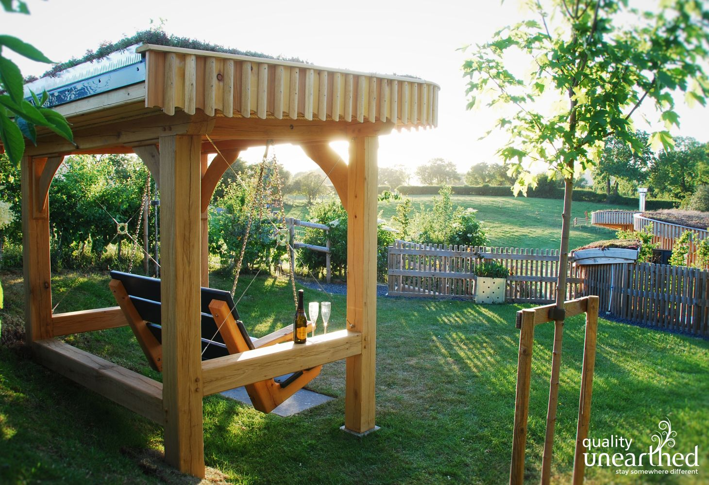 Hand crafted Solid Wood Swing bench with canopy at Malvern Hills Lodge