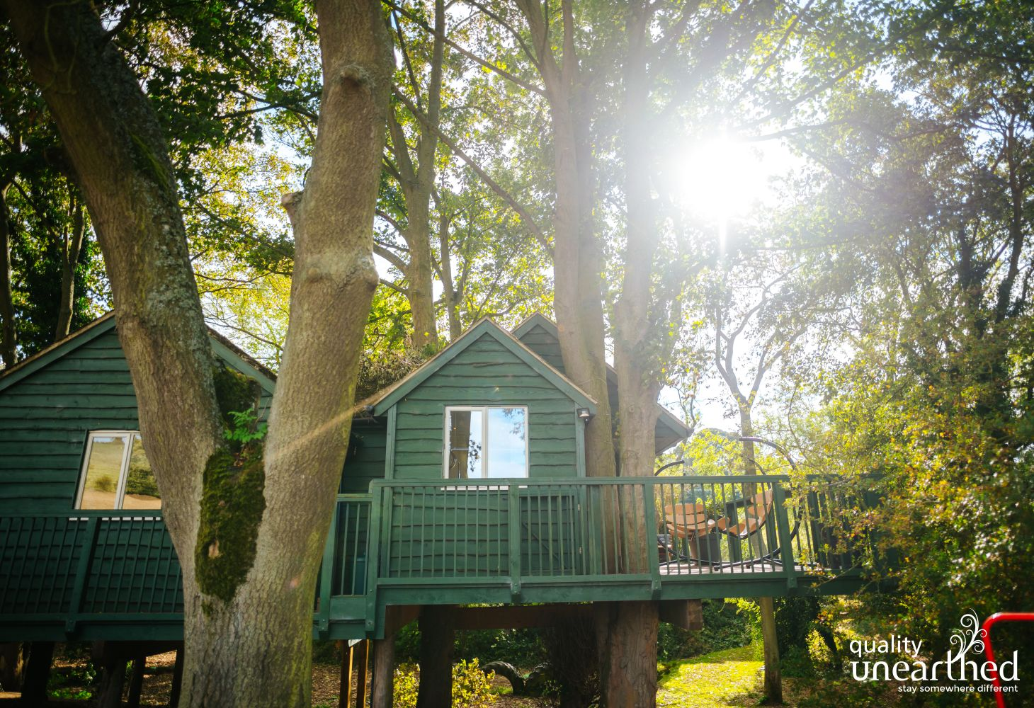 Quirky swinging seats on the treehouse for relaxing de-stress holidays