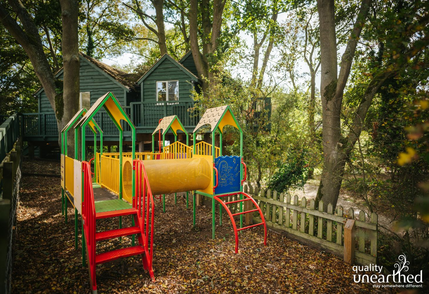 A large kids climbing frame in the woods makes this treehouse just perfect for family breaks