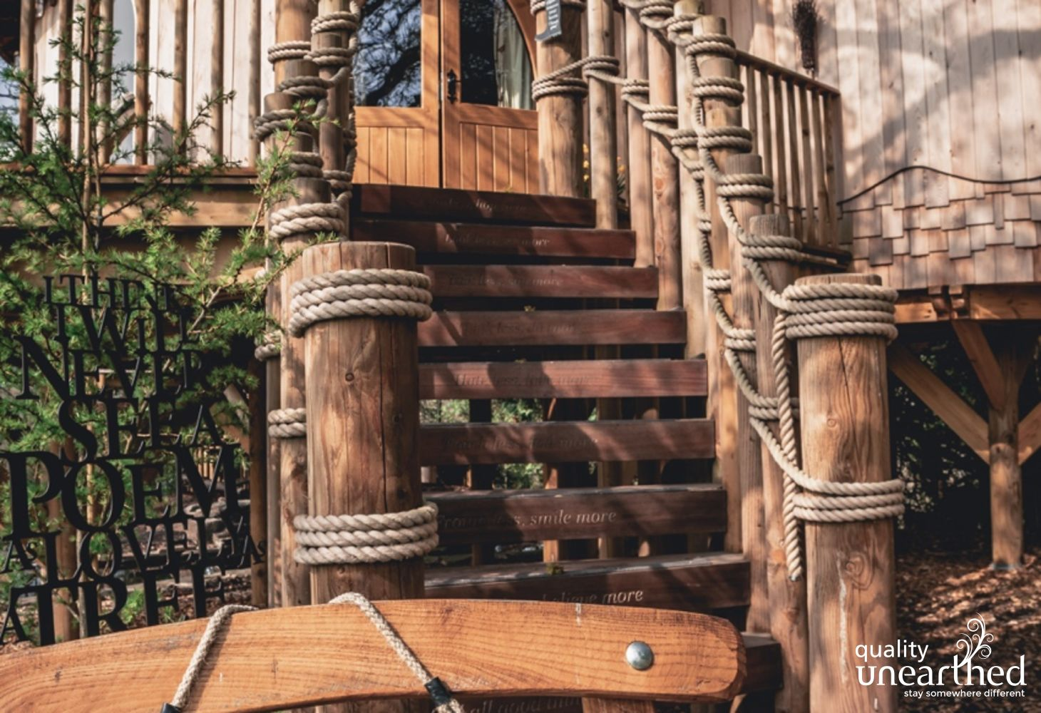 The steps to Trewalter cedar clad treehouse are inscribed with welcoming messages