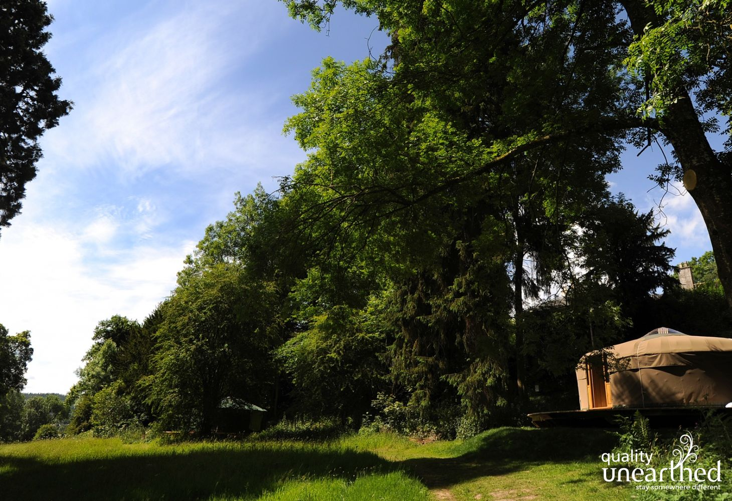 The yurt for 5 sits looking across one of the meadows in this country estate