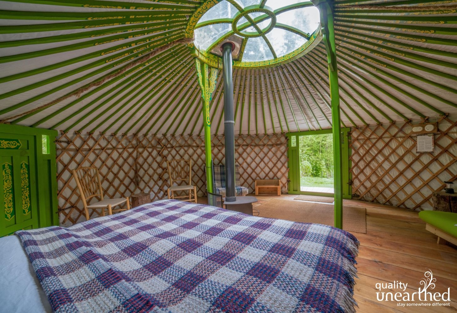A view of the welsh woodland location through the front door of the family sized yurt
