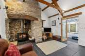 sitting room, lit log burner, stone walls, slate floor, holiday cottage