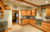Self catering Pembrokeshire cottage - luxury fitted kitchen with door to garden
