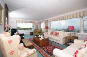 Large holiday cottage, sleeps ten, with sea views - spacious lounge with panoramic views towards the Llyn Peninsula.