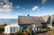 Large holiday cottage with views over Llyn Peninsula and inland to Snowdonia.