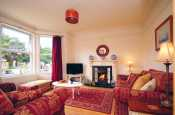 Coastal large holiday cottage in North Wales on the Llyn Peninsula - comfortable lounge. Sleeps 11 people.