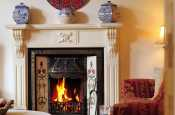 Stylish period Edwardian fireplace in holiday cottage in Morfa Nefyn, on the Llyn Peninsula, North Wales.