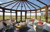 North Pembrokeshire coastal holiday cottage near Porthgain - conservatory with countryside and sea views