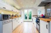 Spacious open-plan kitchen at Sound of the Sea (Swn Y Mor), holiday cottage Rhosneigr. Double doors to garden.