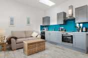Kitchen area luxury fully fitted units electric oven and hob, microwave, fridge/freezer
