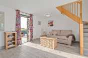 Lounge area with comfy 2 seater sofa and Freeview TV