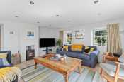 Solva family holiday home on the Pembrokeshire coast - sitting room with log burning stove