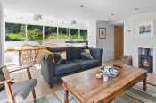 Solva, holiday cottage on the Pembrokeshire coast - sitting room with wood burning stove