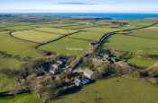 Aerial view of large dog friendly holiday house in quiet hamlet on the St. Davids Peninsula, Pembrokeshire. Sleeps 15.