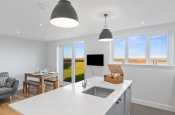 Modern kitchen island with overhead lighting