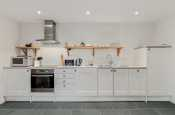 Open plan kitchen fully equipped with appliances