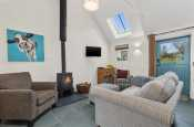 Cosy lounge with log burner, sofa and stable door