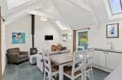 Open plan kitchen-diner and living room with log burner