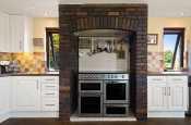 Large kitchen with range cooker at Badger Cottage, Burton.